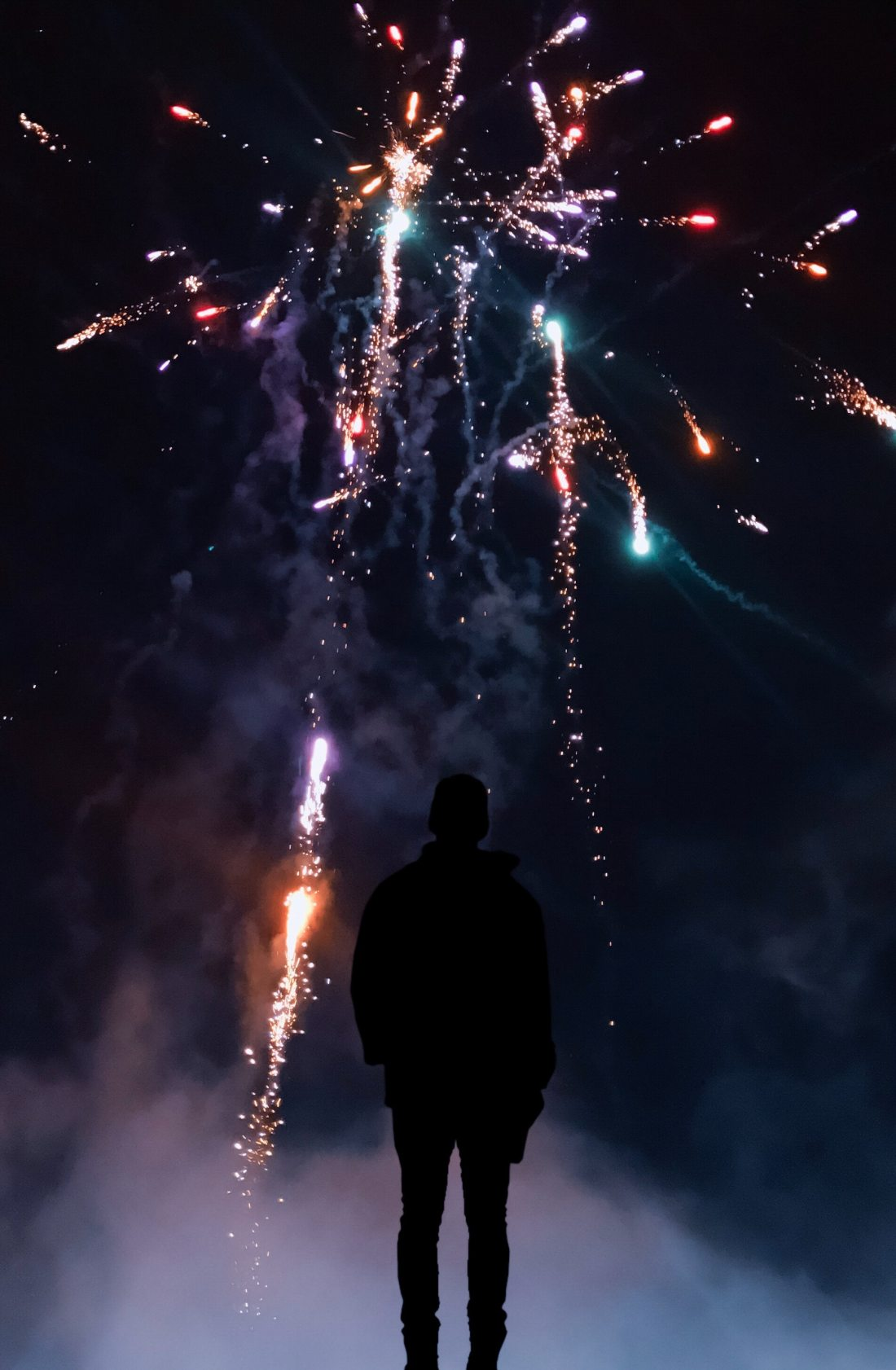 silhouette-of-person-in-front-of-fireworks-2297472